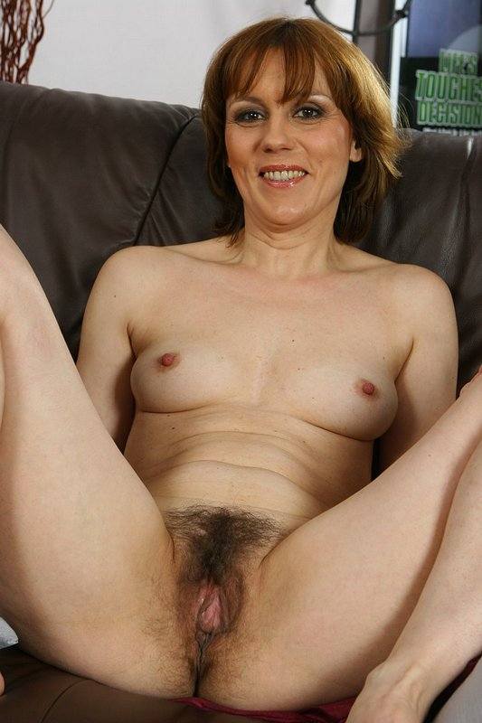 image Busty senior lady rubs her hairy cunt with her fingers